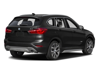 Black Sapphire Metallic 2016 BMW X1 Pictures X1 Utility 4D 28i AWD I4 Turbo photos rear view