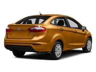 Electric Spice Metallic 2016 Ford Fiesta Pictures Fiesta Sedan 4D SE I4 photos rear view