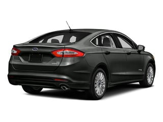 Magnetic 2016 Ford Fusion Pictures Fusion Sedan 4D S I4 Hybrid photos rear view