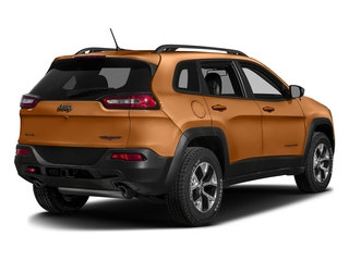 Mango Tango Pearlcoat 2016 Jeep Cherokee Pictures Cherokee Utility 4D Trailhawk 4WD photos rear view