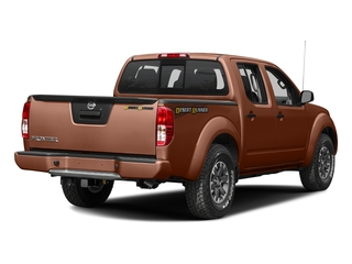 Forged Copper 2016 Nissan Frontier Pictures Frontier Crew Cab Desert Runner 2WD photos rear view