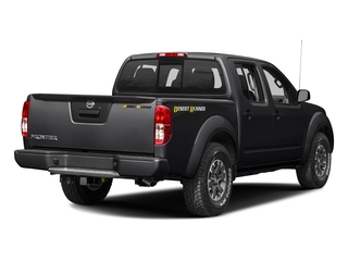 Magnetic Black 2016 Nissan Frontier Pictures Frontier Crew Cab Desert Runner 2WD photos rear view