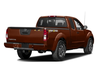 Forged Copper 2016 Nissan Frontier Pictures Frontier King Cab Desert Runner 2WD photos rear view