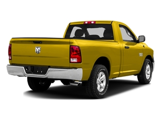 Yellow 2016 Ram Truck 1500 Pictures 1500 Regular Cab SLT 2WD photos rear view