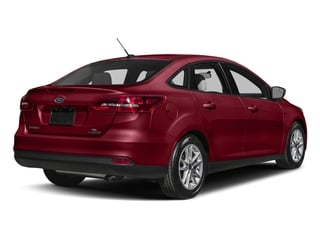 Ruby Red Metallic Tinted Clearcoat 2017 Ford Focus Pictures Focus Sedan 4D SE I4 photos rear view