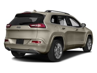 Light Brownstone Pearlcoat 2017 Jeep Cherokee Pictures Cherokee Utility 4D Overland 4WD photos rear view