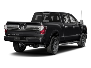 Magnetic Black 2017 Nissan Titan XD Pictures Titan XD Crew Cab Platinum Reserve 4WD photos rear view