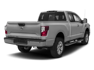 Brilliant Silver 2017 Nissan Titan XD Pictures Titan XD Extended Cab S 4WD photos rear view