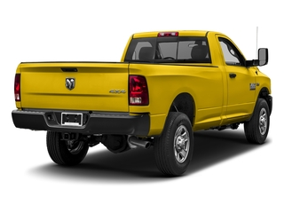 Yellow 2017 Ram Truck 3500 Pictures 3500 Regular Cab SLT 2WD photos rear view