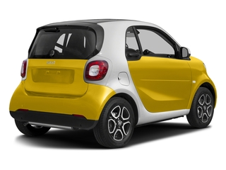 Black-to-Yellow Metallic 2017 smart fortwo Pictures fortwo Coupe 2D Proxy I3 Turbo photos rear view