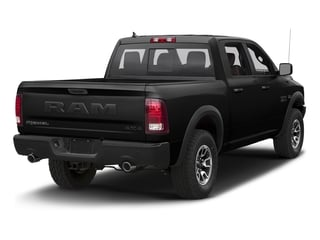 Brilliant Black Crystal Pearlcoat 2018 Ram Truck 1500 Pictures 1500 Rebel 4x4 Crew Cab 5'7 Box photos rear view