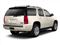 Gold Mist Metallic 2010 GMC Yukon Pictures Yukon Utility 4D SLE 4WD photos rear view