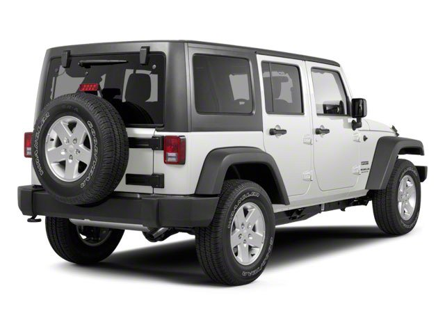 Bright White Clear Coat 2011 Jeep Wrangler Unlimited Pictures Wrangler Unlimited Utility 4D Unlimited Sahara 4WD photos rear view