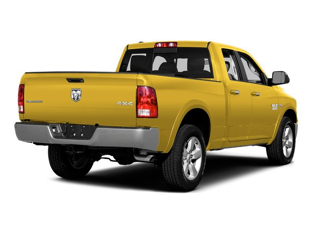 Yellow 2015 Ram Truck 1500 Pictures 1500 Quad Cab Express 4WD photos rear view
