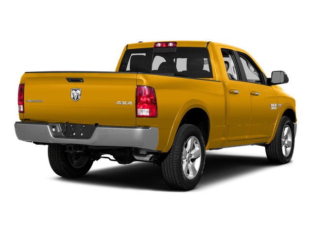 Construction Yellow 2015 Ram Truck 1500 Pictures 1500 Quad Cab SLT 2WD photos rear view