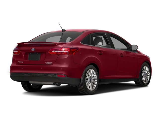 Ruby Red Metallic Tinted Clearcoat 2016 Ford Focus Pictures Focus Sedan 4D Titanium I4 photos rear view