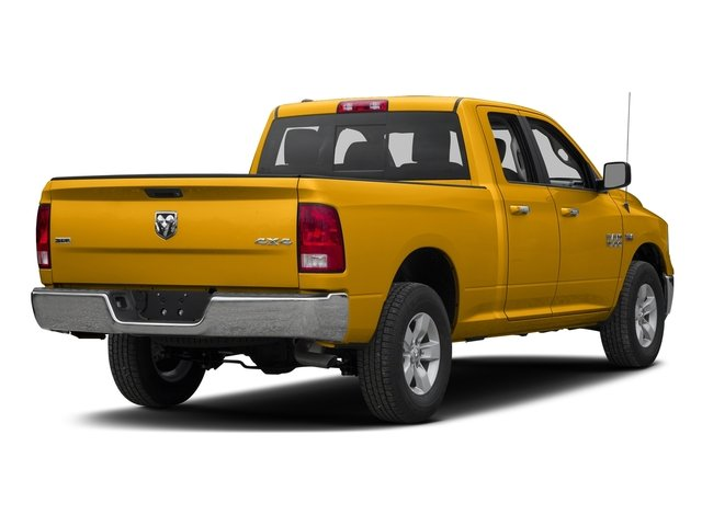 Construction Yellow 2016 Ram Truck 1500 Pictures 1500 Quad Cab SLT 4WD photos rear view