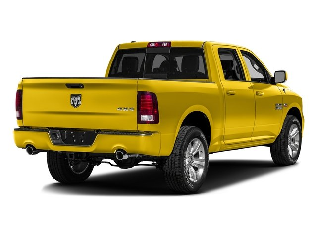 Yellow 2016 Ram Truck 1500 Pictures 1500 Crew Cab Outdoorsman 4WD photos rear view