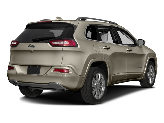 Light Brownstone Pearlcoat 2017 Jeep Cherokee Pictures Cherokee Utility 4D Overland 2WD photos rear view