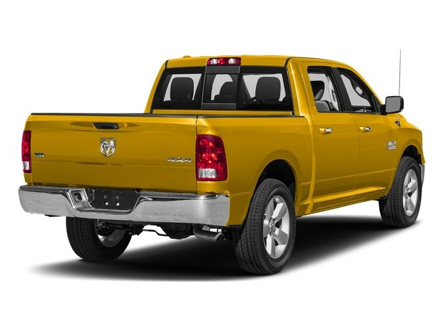 Yellow 2017 Ram Truck 1500 Pictures 1500 Crew Cab SLT 4WD photos rear view