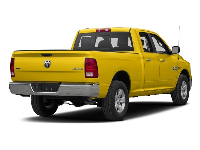 Yellow 2017 Ram Truck 1500 Pictures 1500 Quad Cab SLT 2WD photos rear view