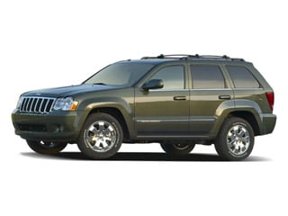 2009 Jeep Grand Cherokee Pictures Grand Cherokee Utility 4D Laredo 4WD photos side front view