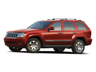 2010 Jeep Grand Cherokee Pictures Grand Cherokee Utility 4D Laredo 2WD photos side front view