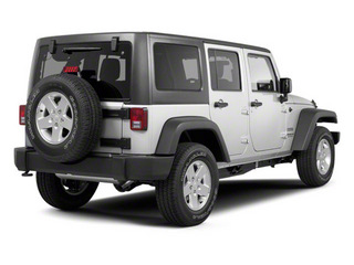2012 Jeep Wrangler Unlimited Pictures Wrangler Unlimited Utility 4D Unlimited Altitude 4WD V6 photos side rear view