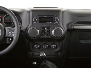 2012 Jeep Wrangler Unlimited Pictures Wrangler Unlimited Utility 4D Unlimited Altitude 4WD V6 photos center dashboard