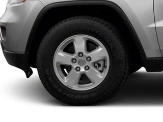 2013 Jeep Grand Cherokee Pictures Grand Cherokee Utility 4D Overland 4WD photos wheel