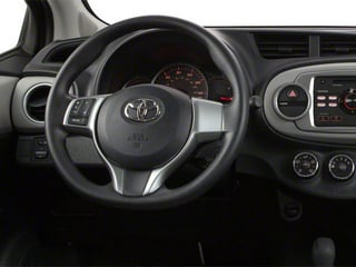2013 Toyota Yaris Pictures Yaris Hatchback 5D LE I4 photos driver's dashboard