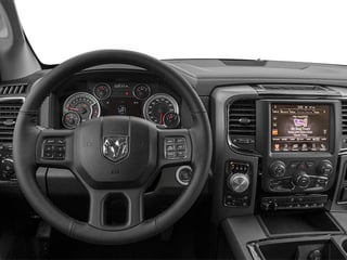 2014 Ram 1500 Pictures 1500 Quad Cab Sport 4WD photos driver's dashboard