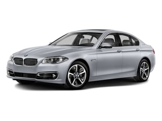 2016 BMW 5 Series Pictures 5 Series Sedan 4D ActiveHybrid 5 I6 Turbo photos side front view