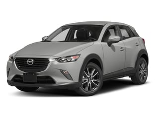 2018 Mazda CX-3 Pictures CX-3 Touring FWD photos side front view