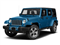 2016 Jeep Wrangler Unlimited Pictures Wrangler Unlimited Utility 4D Unlimited Sahara 4WD V6 photos side front view