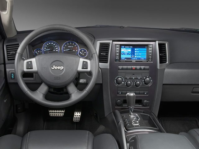 2009 Jeep Grand Cherokee Pictures Grand Cherokee Utility 4D Laredo 4WD photos driver's dashboard