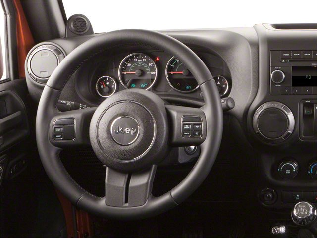 2010 Jeep Wrangler Prices and Values Utility 2D Sport 4WD driver's dashboard