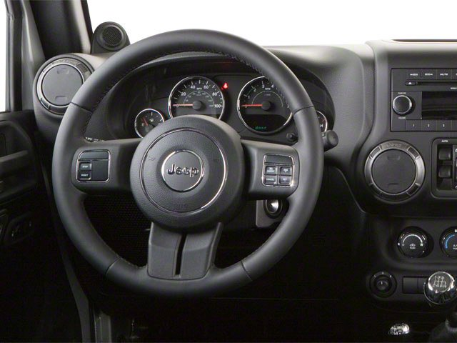 2010 Jeep Wrangler Unlimited Prices and Values Utility 4D Unlimited Sport 4WD driver's dashboard