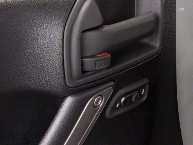 2010 Jeep Wrangler Unlimited Prices and Values Utility 4D Unlimited Sport 4WD driver's side interior controls