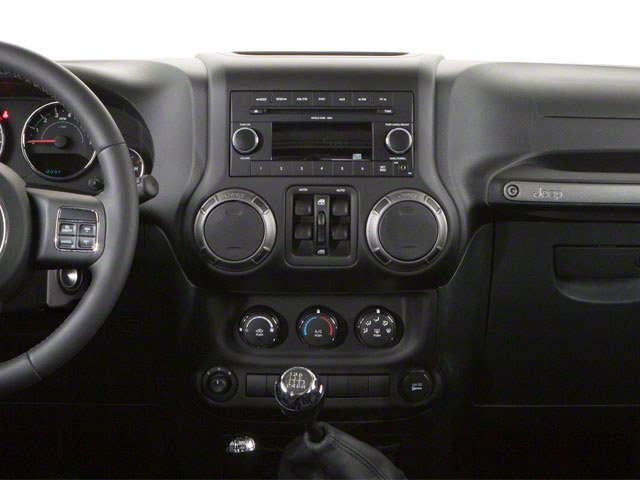 2010 Jeep Wrangler Unlimited Prices and Values Utility 4D Unlimited Sport 4WD center dashboard