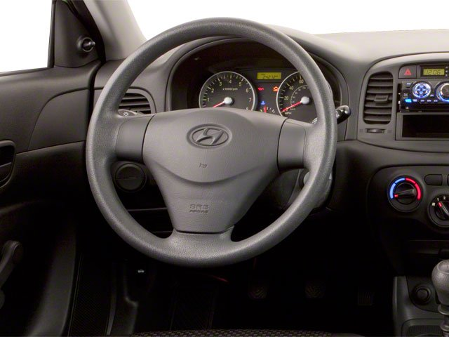 2011 Hyundai Accent Prices and Values Hatchback 3D GL driver's dashboard