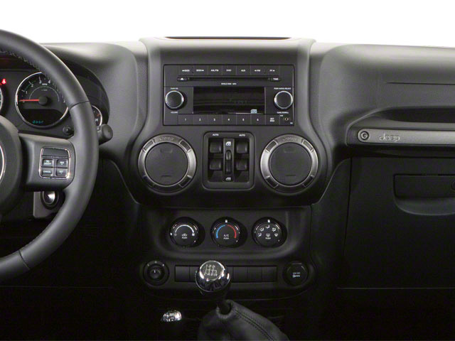 2011 Jeep Wrangler Unlimited Pictures Wrangler Unlimited Utility 4D Unlimited Sahara 4WD photos center dashboard