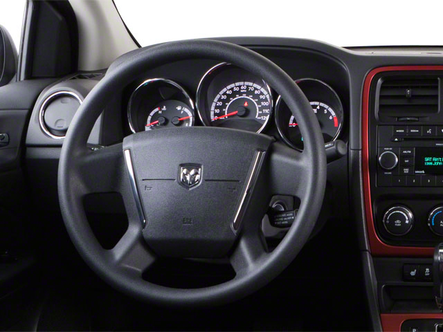 2012 Dodge Caliber Prices and Values Wagon 4D SXT driver's dashboard