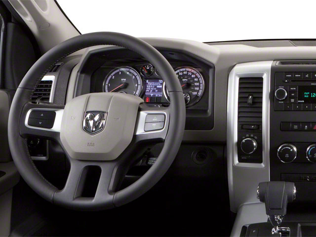 2012 Ram Truck 1500 Pictures 1500 Quad Cab SLT 4WD photos driver's dashboard