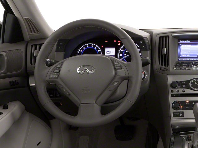 2012 INFINITI G25 Sedan Prices and Values Sedan 4D driver's dashboard