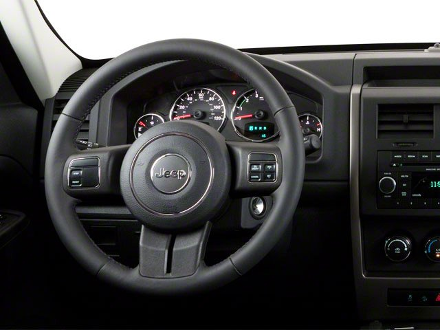 2012 Jeep Liberty Prices and Values Utility 4D Sport 2WD driver's dashboard