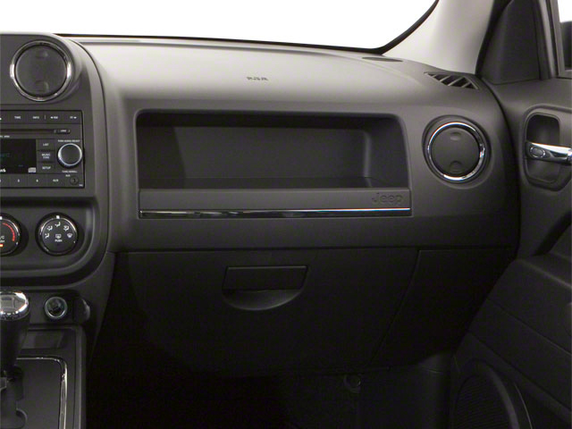 2012 Jeep Patriot Prices and Values Utility 4D Latitude 4WD passenger's dashboard