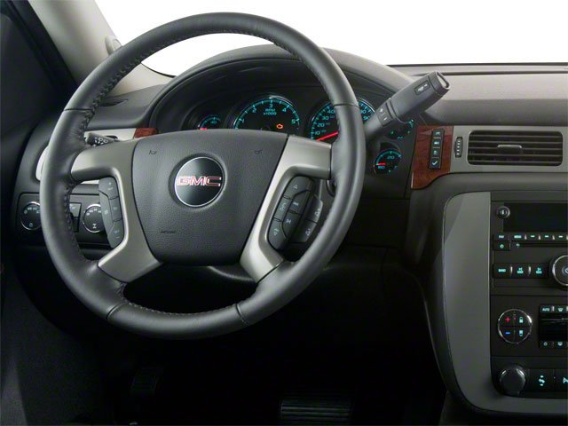 2013 GMC Yukon Hybrid Prices and Values Utility 4D Hybrid 2WD driver's dashboard