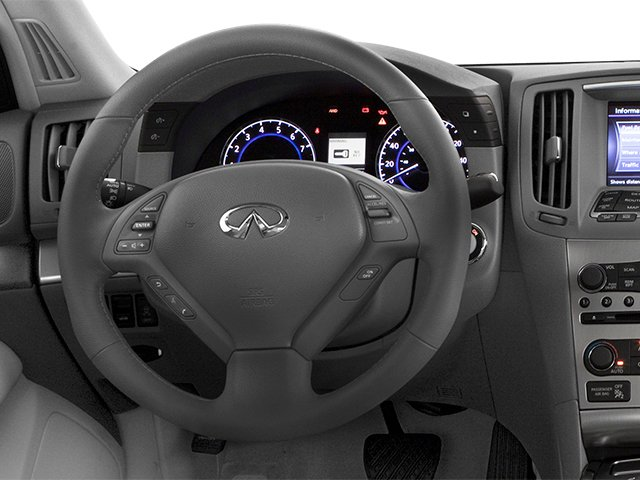 2013 INFINITI G37 Sedan Prices and Values Sedan 4D V6 driver's dashboard