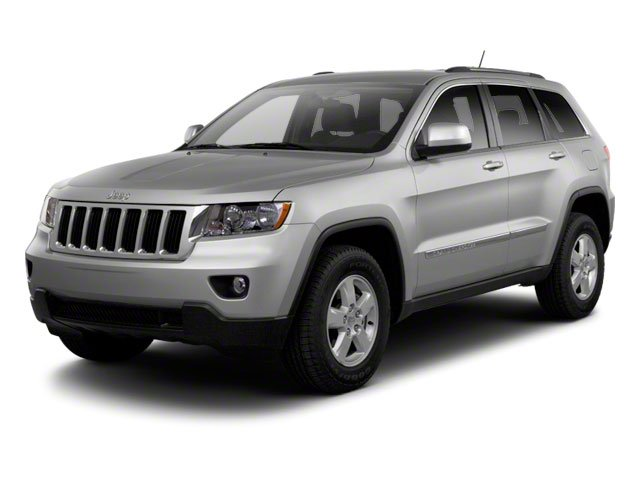 2013 Jeep Grand Cherokee Prices and Values Utility 4D Overland 4WD side front view